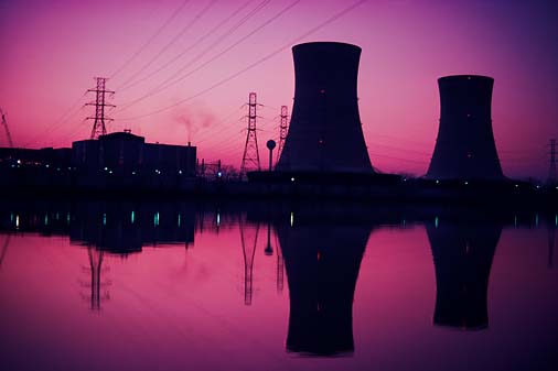 Silhouette of nuclear power plant at sunset